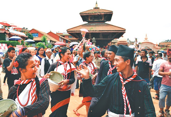 People celebrating Gai Jatra festival in Bhaktapur